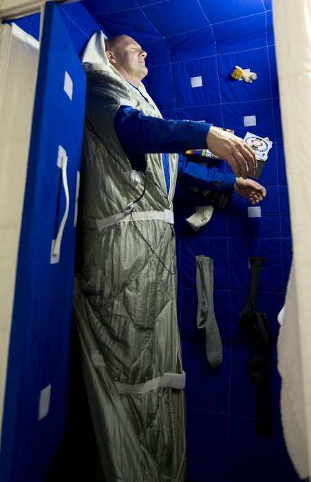 ESA Astronaut Andre Kuipers Tries Out The Space Station Bedroom Mock Up At EAC
