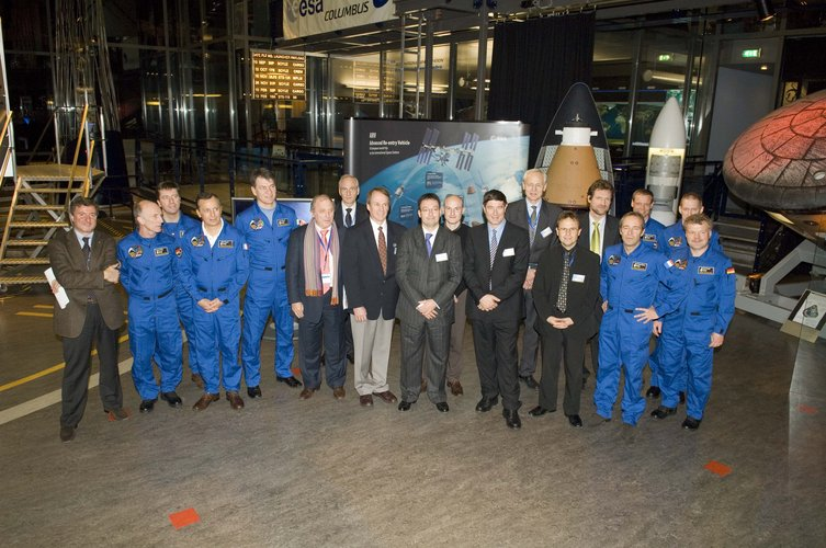 Members of the European Astronaut Corps and Ministerial Council delegates pose for a photo in ESTEC's Erasmus Centre