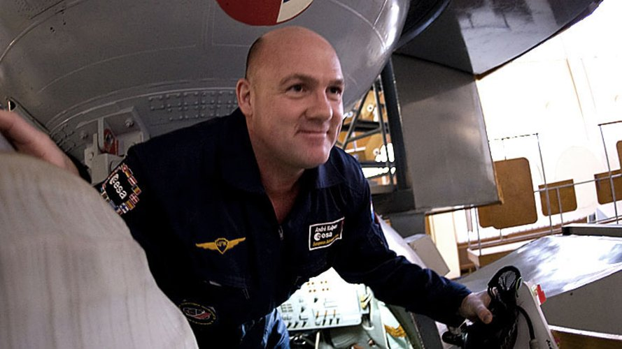 André Kuipers climbs out of the Soyuz simulator at Star City