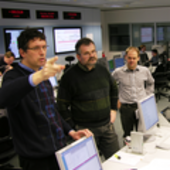 ESA flight dynamics specialists brainstorming solutions