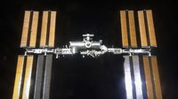 International Space Station is seen from Space Shuttle Discovery