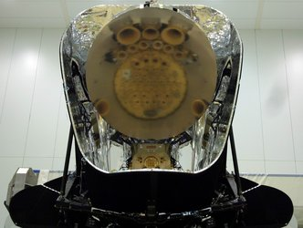 Planck instruments reflected in the telescope primary mirror