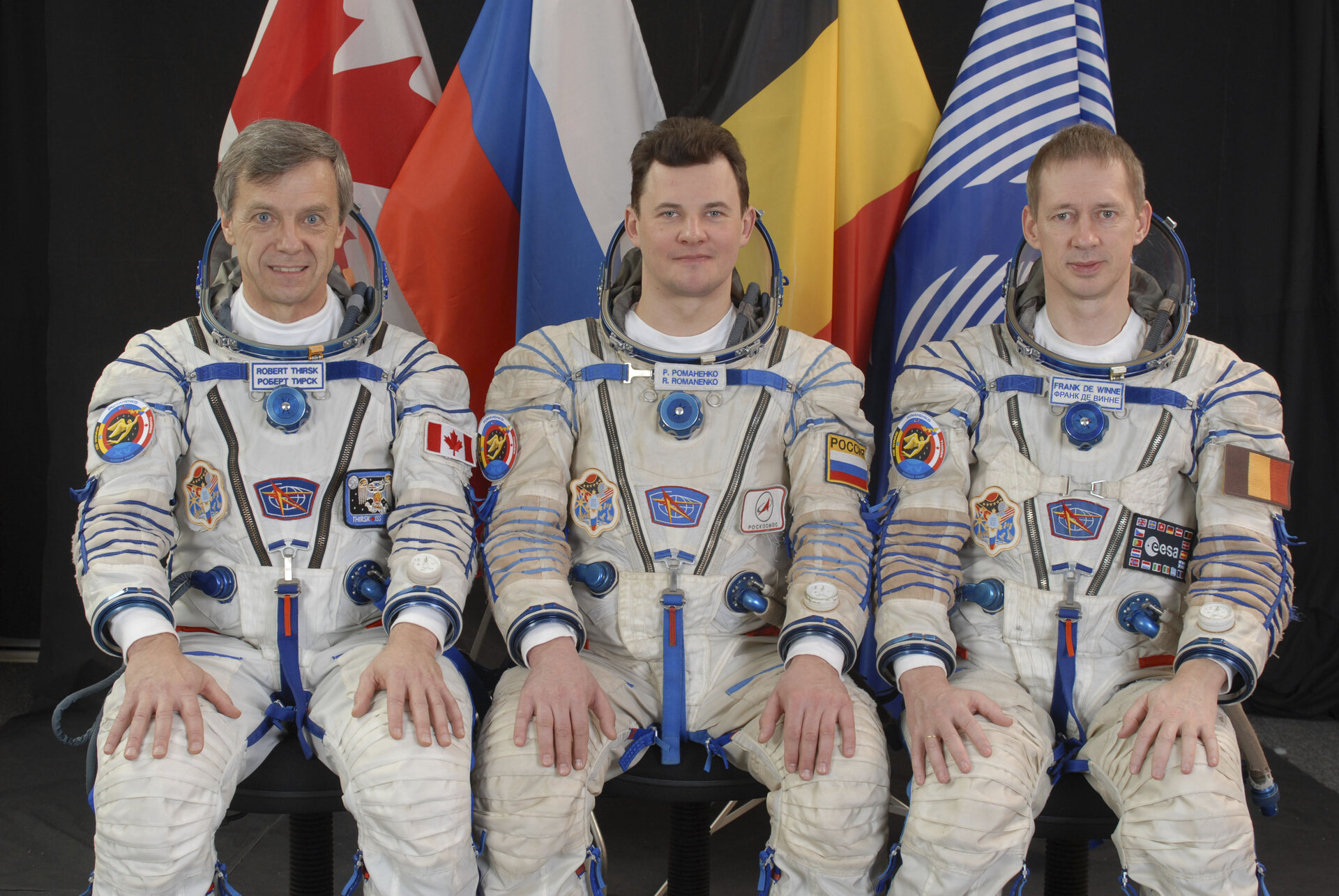 Frank De Winne with fellow ISS Expedition 20/21 crewmembers Robert Thirsk and Roman Romanenko