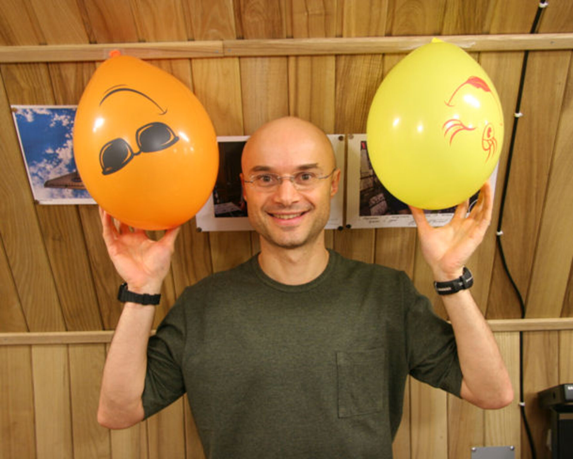 Cyrille with two of the balloons used to decorate the module for Oliver's birthday