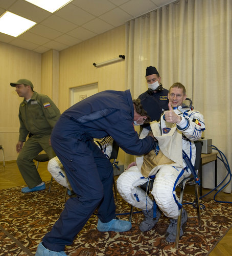 Frank De Winne dons his Russian Sokol suit