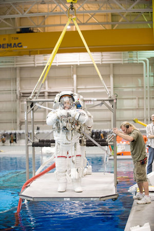 John Olivas and Christer Fuglesang are lowered into the water for spacewalk training