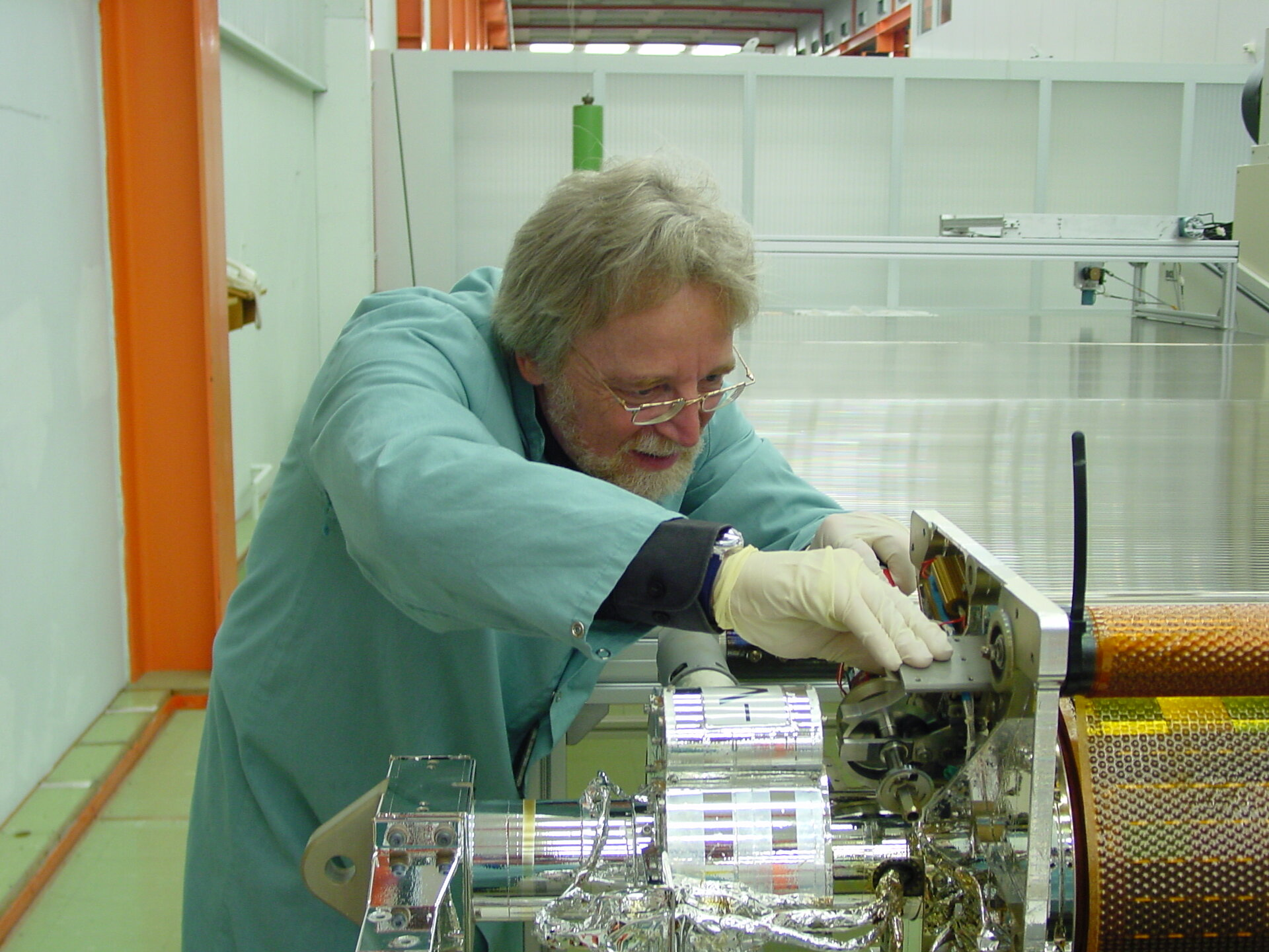 Lothar Gerlach, Head of ESA's Solar Generator section, examines solar cells