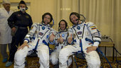 Soyuz TMA-15 crew dressed in their Russian Sokol suits