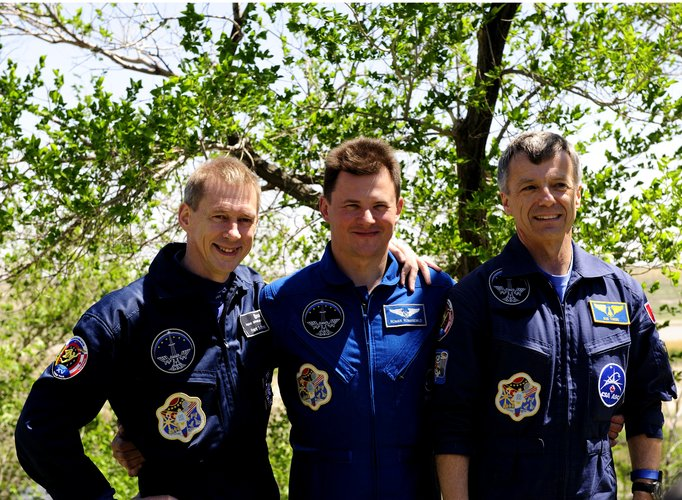The Soyuz TMA-15 crew take part in the traditional tree-planting ceremony ahead of their launch to the ISS