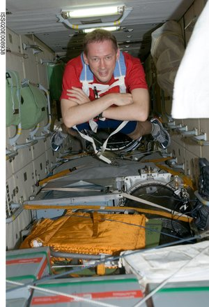 ESA astronaut Frank De Winne floats through the Zarya module