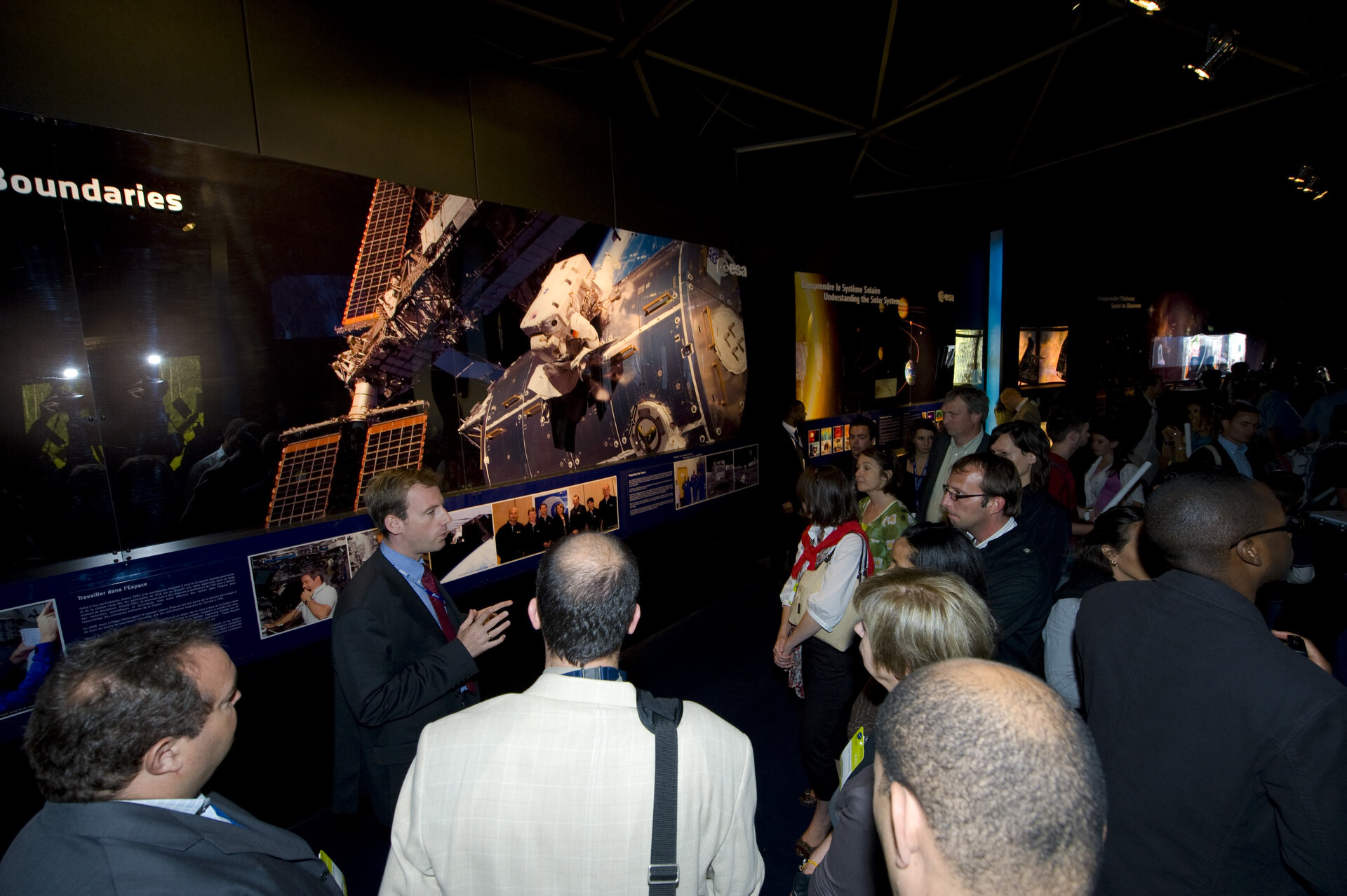 ESA staff receive a guided tour of the ESA Pavilion at Le Bourget