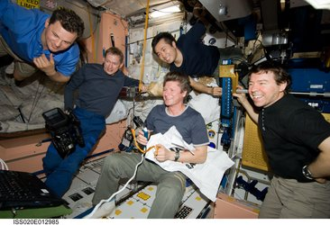 Expedition 20 crewmembers gather for a celebration of Father's day and a birthday
