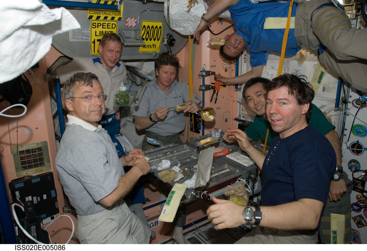 Expedition 20 crewmembers share a meal in the Unity node of the ISS