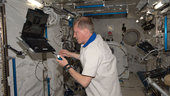 Frank De Winne works in the Kibo laboratory of the ISS