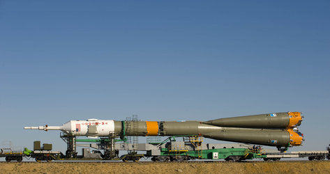 Horizontal rollout of Soyuz launch vehicle and TMA-15 spacecraft