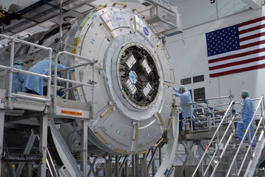 Node 3 is lowered onto a work stand in the Space Station Processing Facility at KSC