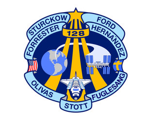 The STS-128 mission patch