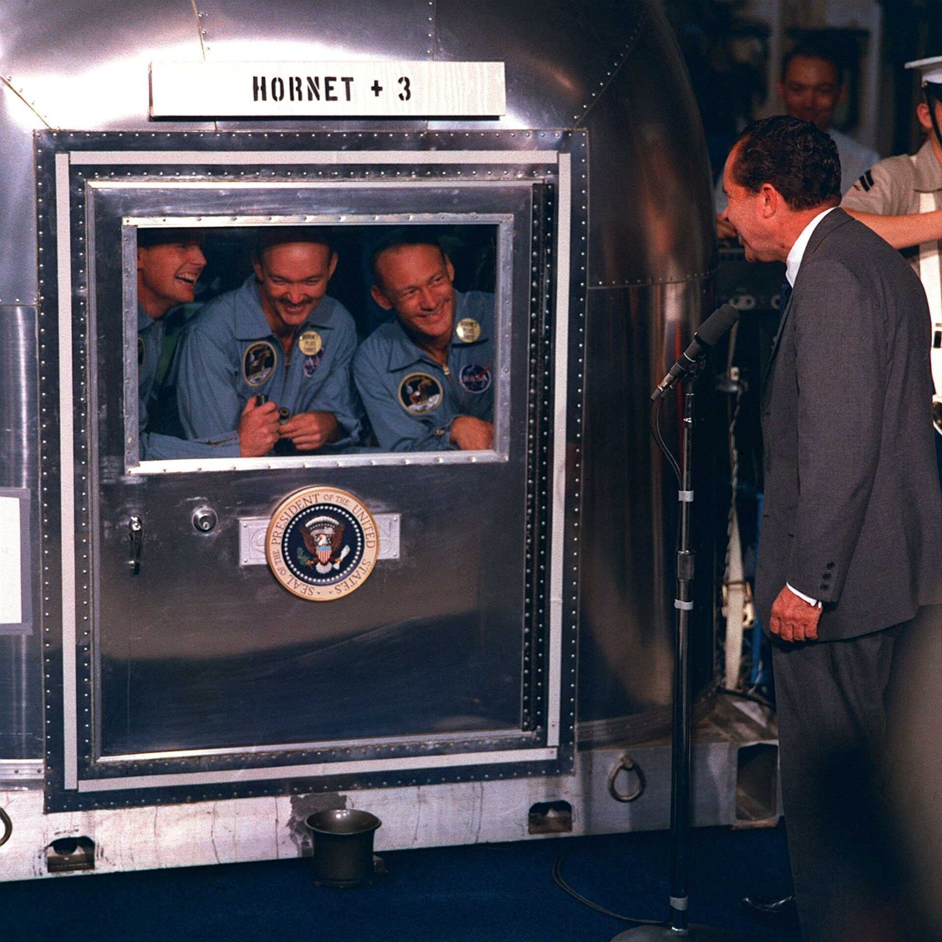 President Nixon greets the Apollo 11 crew after splashdown