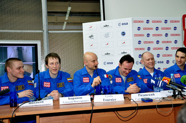 The Mars500 crew attend a press conference after completion of the 105-day study