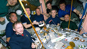 Expedition 20 and STS-127 crews share a meal on the ISS