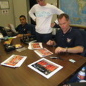 Autographing the crew photo