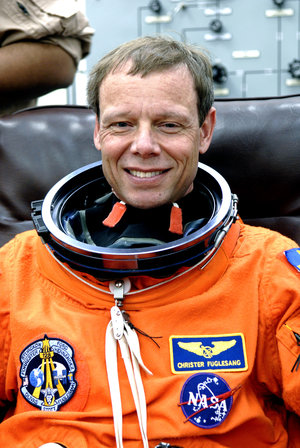 Christer Fuglesang dons launch and entry suit for simulated launch countdown