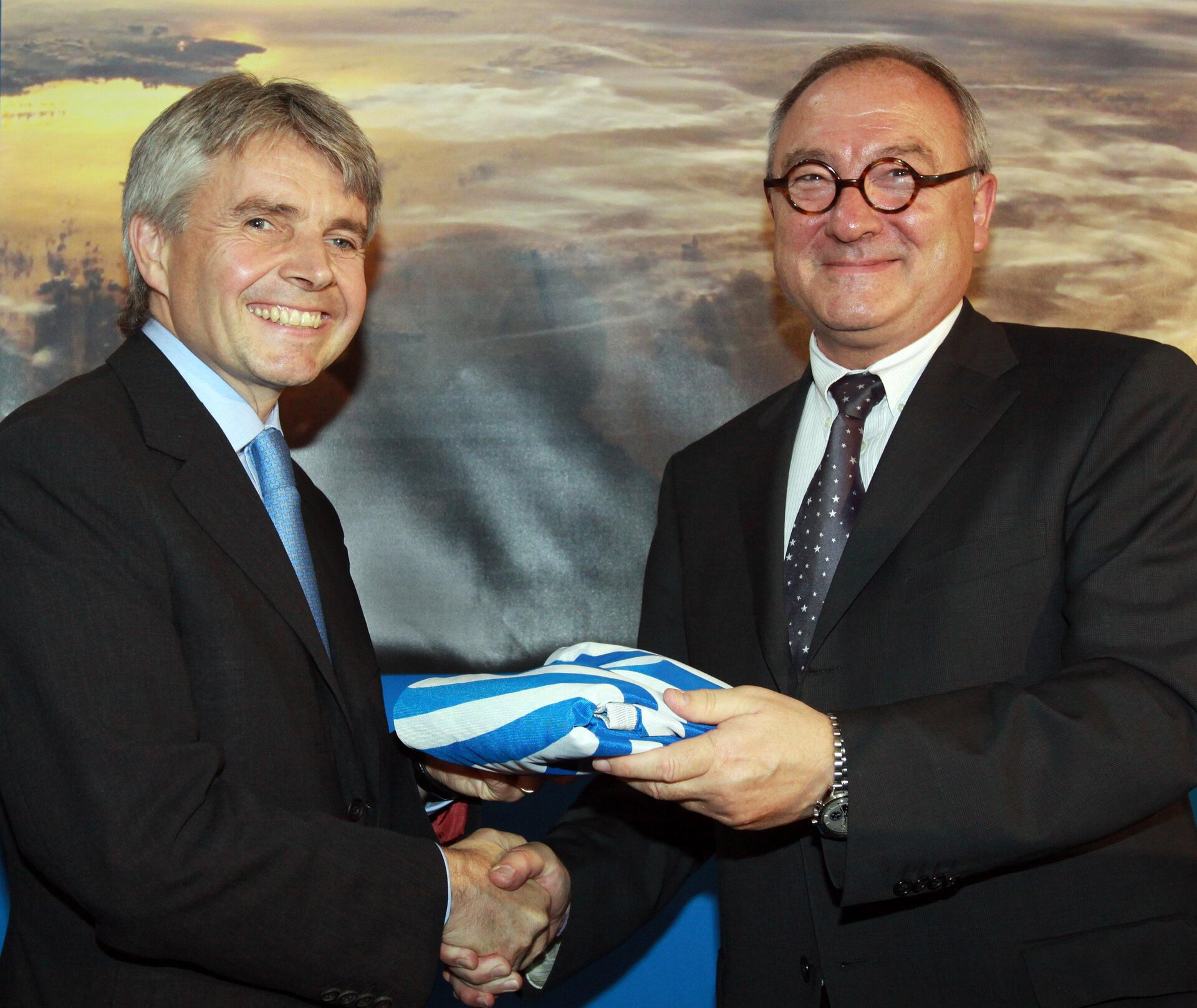 ESA Director General Jean-Jacques Dordain presents ESA flag to Lord Drayson, UK Minister for Science and Innovation