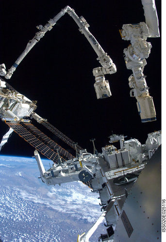 Portion of the Japanese Experiment Module - Exposed Facility and the Space Station and Shuttle robotic arms