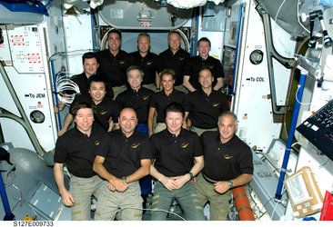 The STS-127 and Expedition 20 crewmembers pose for a group portrait