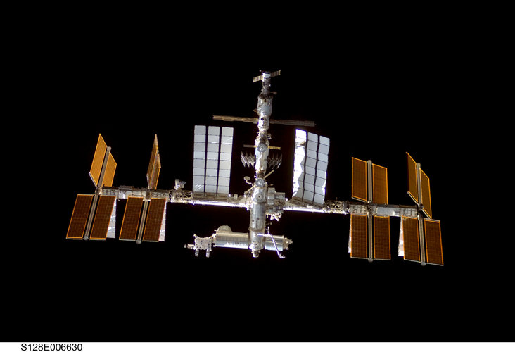 A view of the ISS from Discovery shortly before docking of the STS-128 mission
