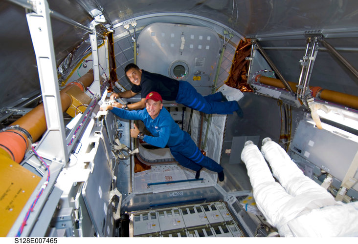 At work inside the Leonardo Multi-Purpose Logistics Module during the STS-128 mission