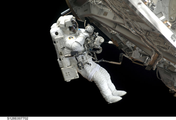 Christer Fuglesang participates in the third STS-128 spacewalk outside the ISS