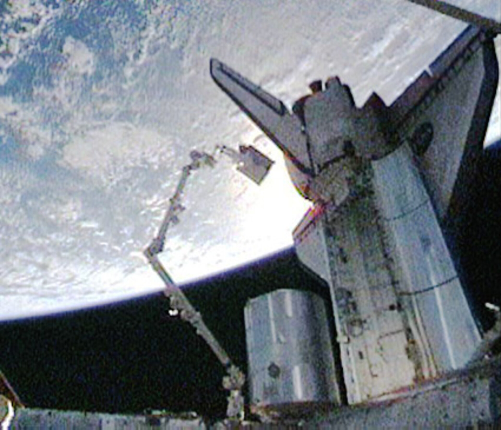 Christer Fuglesang rides the Shuttle robotic arm during the second STS-128 spacewalk