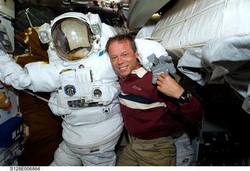 ESA astronaut Christer Fuglesang with EVA spacesuit on Shuttle middeck
