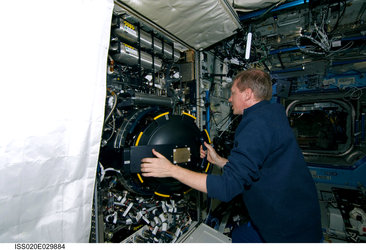 ESA astronaut Frank De Winne at work in the Destiny laboratory