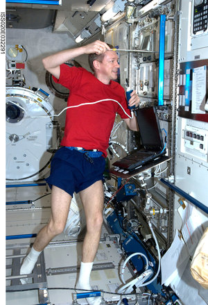 ESA astronaut Frank De Winne works in the Japanese Kibo laboratory