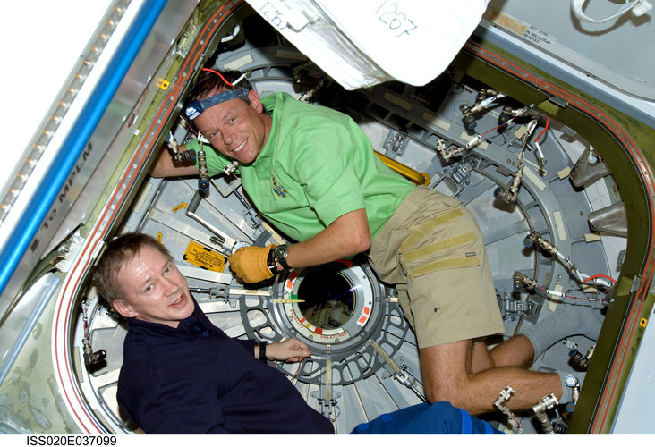 ESA astronauts Frank De Winne and Christer Fuglesang work inside the Harmony module
