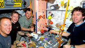 Expedition 20 crewmembers share a meal at the galley in Unity