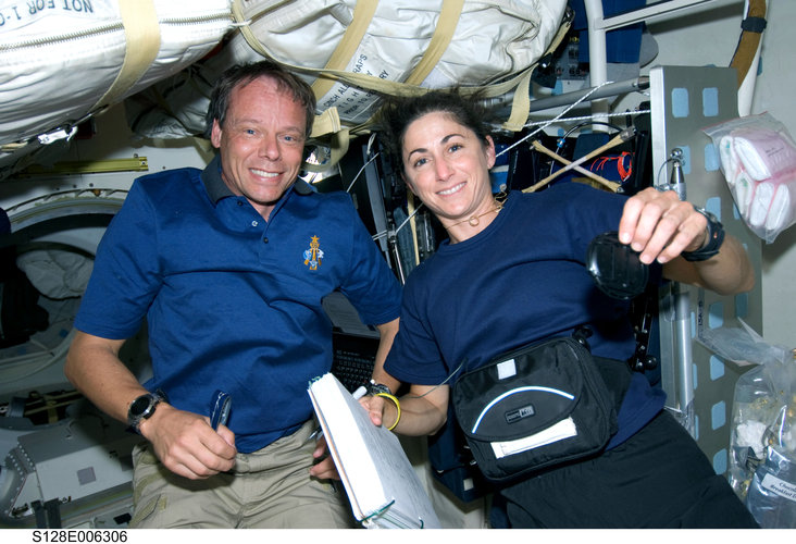 Fuglesang and Stott work on Shuttle middeck during STS-128