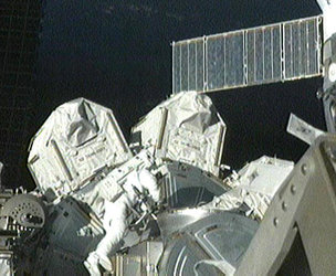 Fuglesang exits Quest Airlock at start of the third STS-128 spacewalk