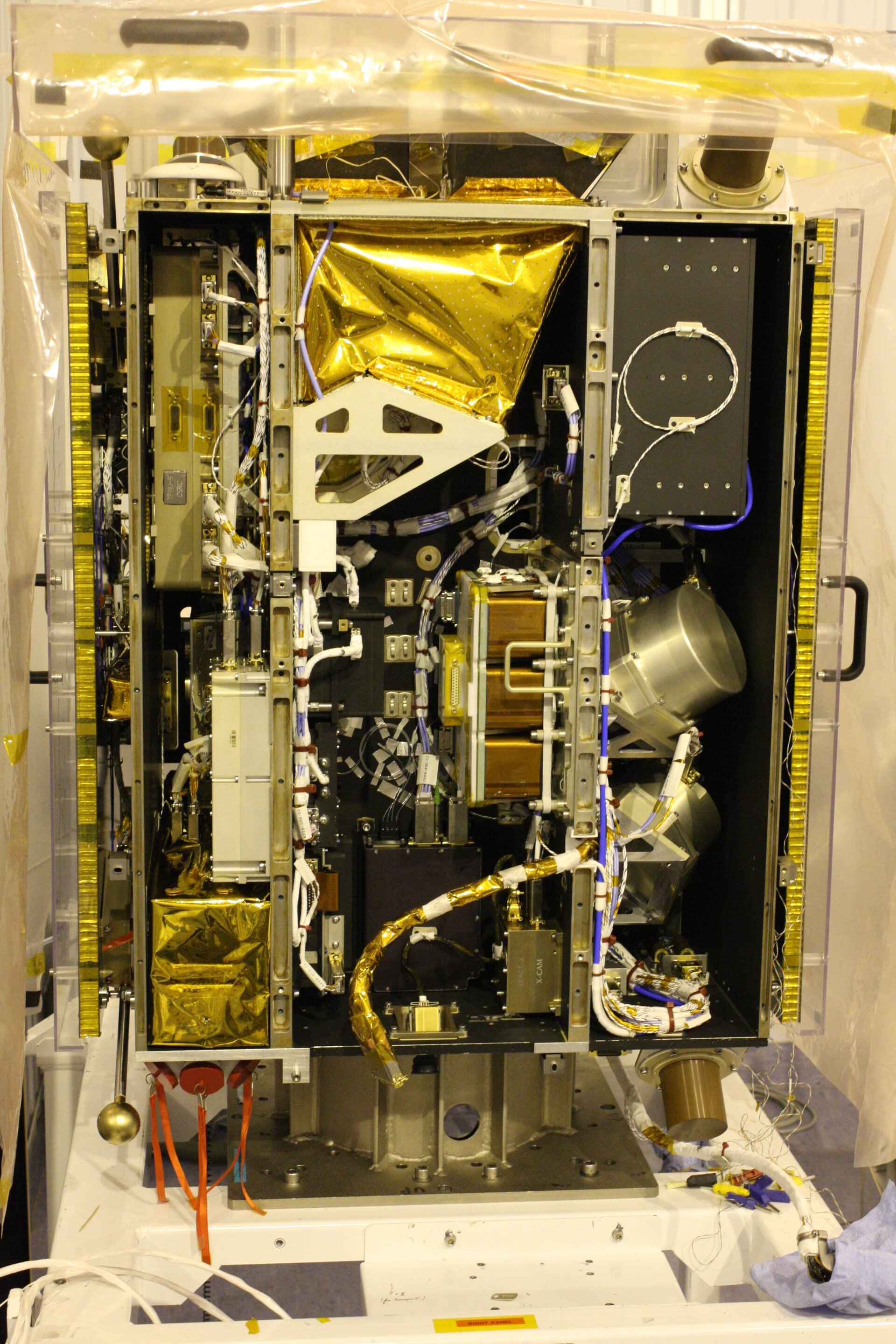 Inside view of spacecraft with battery mounted, prior to closure