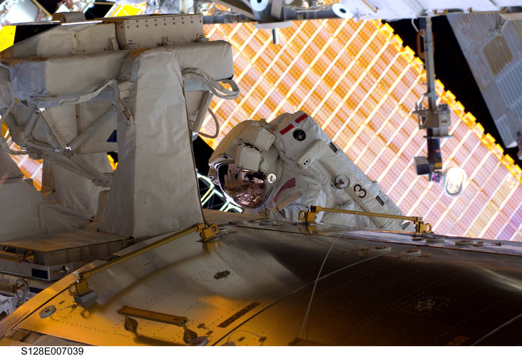 NASA astronaut Nicole Stott works to remove the EuTEF from the outside of Columbus