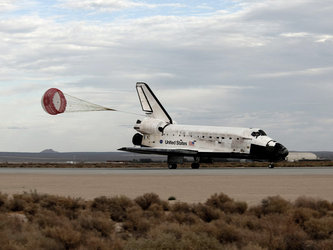 Space Shuttle Discovery slows to a stop after landing at Edwards Air Force Base at the end of the STS-128 mission