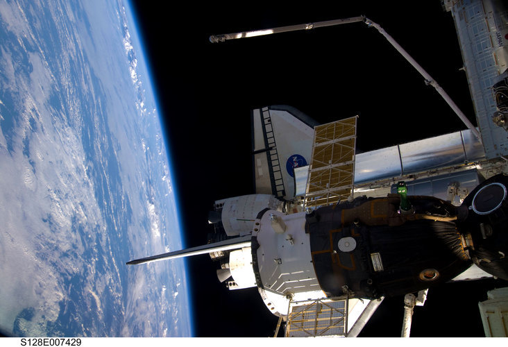 View from the ISS showing Space Shuttle Discovery and a Soyuz spacecraft docked