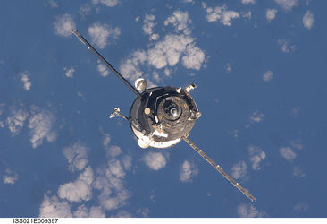 An unpiloted Progress spacecraft approaches the ISS for docking