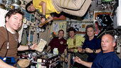 Expedition 20/21 crew share a meal in Zvezda