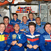 Crewmembers pose for group photos in Harmony