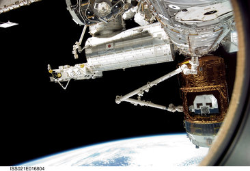 Canadarm2 grapples the Japanese H-II Transfer Vehicle in preparation for its release