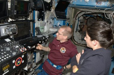 Frank De Winne and Nicole Stott with Canadarm 2 workstation