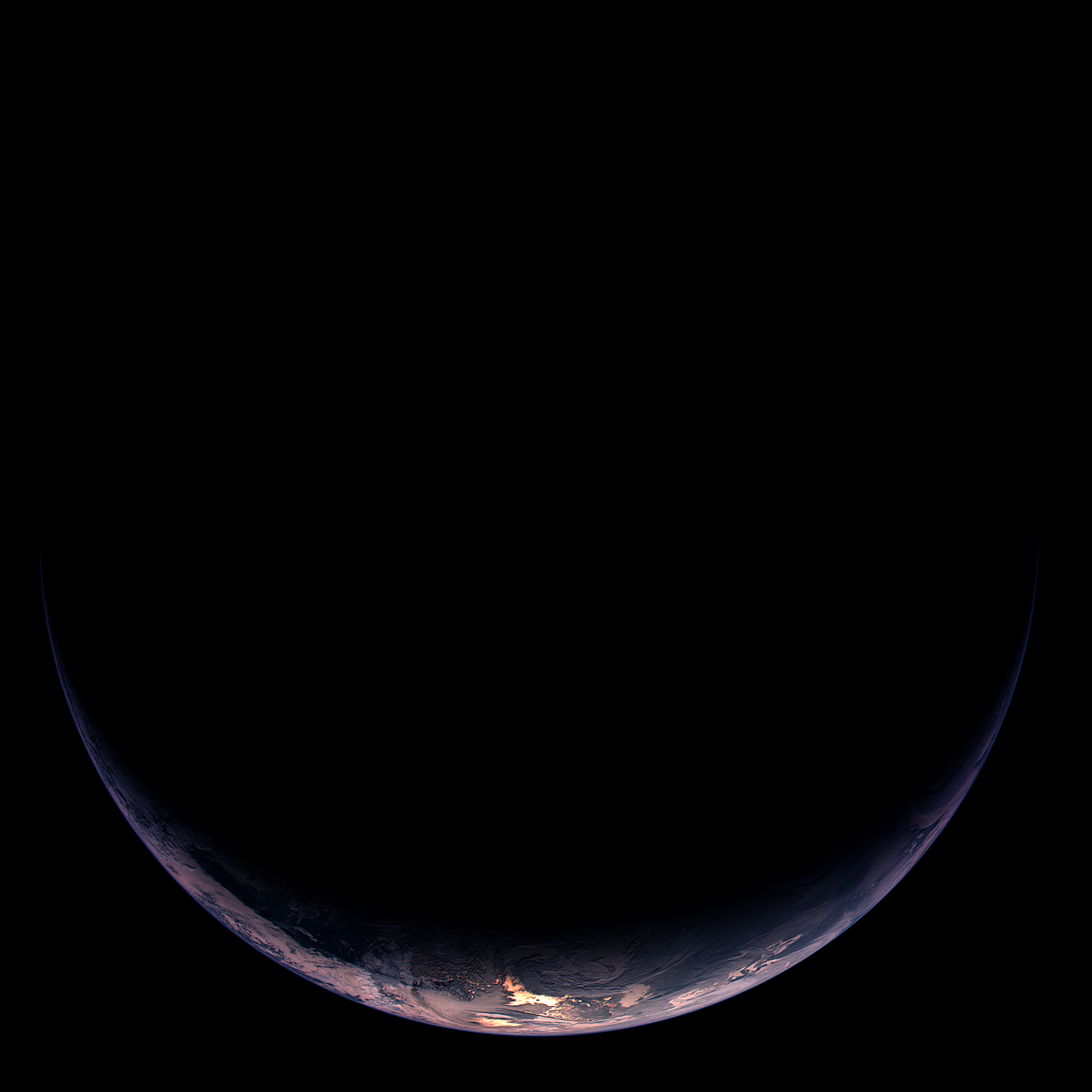 Illuminated crescent of Earth showing part of South America and Antarctica